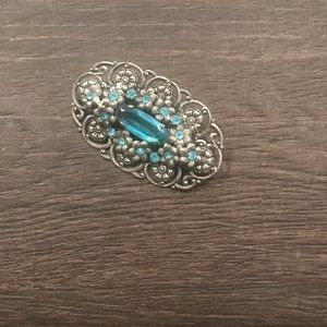 Retro brooch in silver and blue.